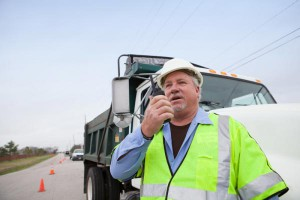 truck driver using two way radio