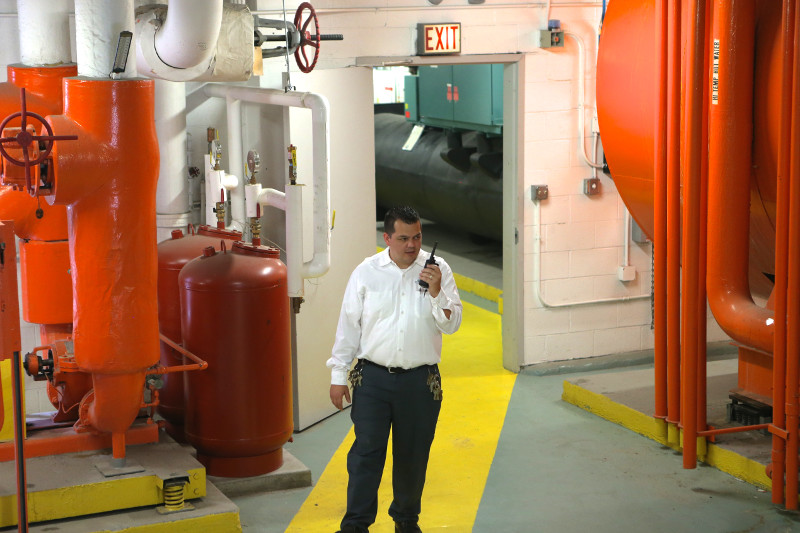 Man using XPR two-way radio in industrial space