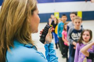 Teacher using 2-way radio in school
