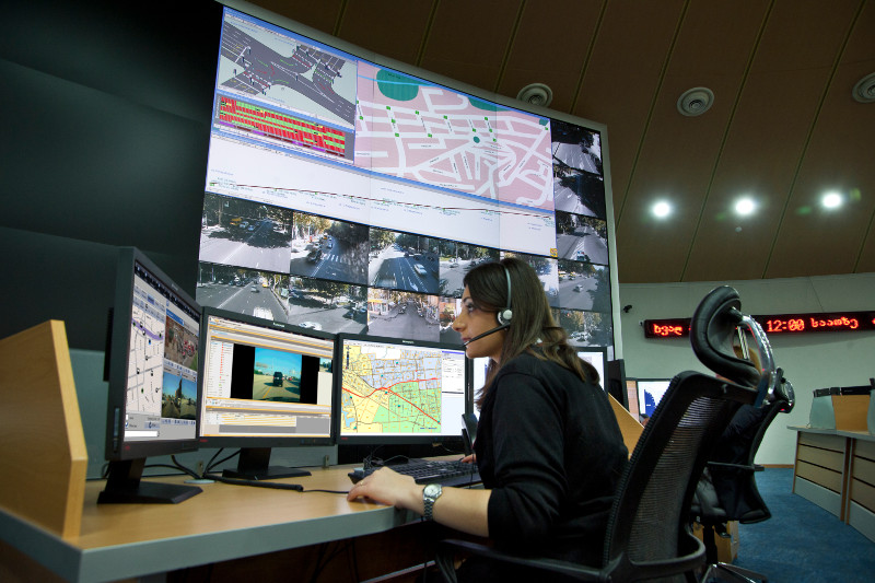 woman in dispatch centre communicates on two-way radio