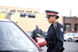 police officer with two way radio and tablet