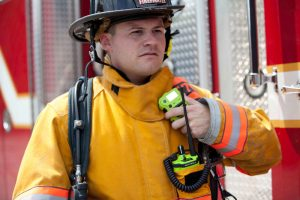 public safety worker communicates on two-way radio