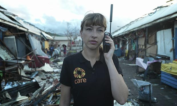 non-profit worker in remote site uses satellite phone